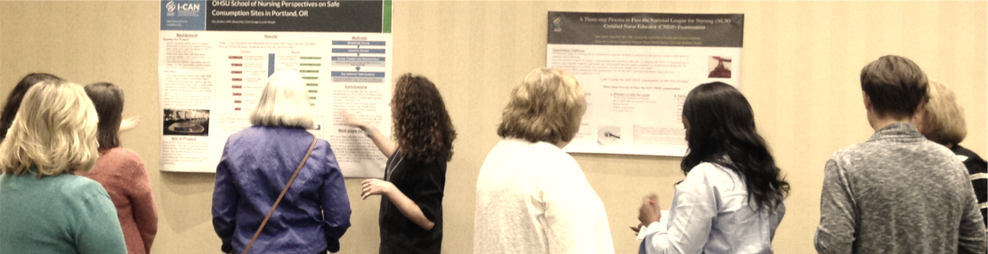 OCNE Faculty viewing posters at a poster session